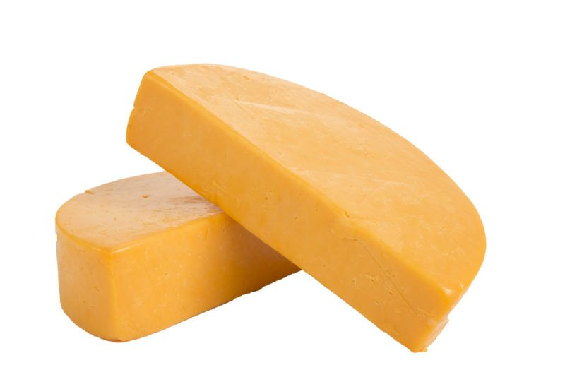 Colby cheese wheels against a white background