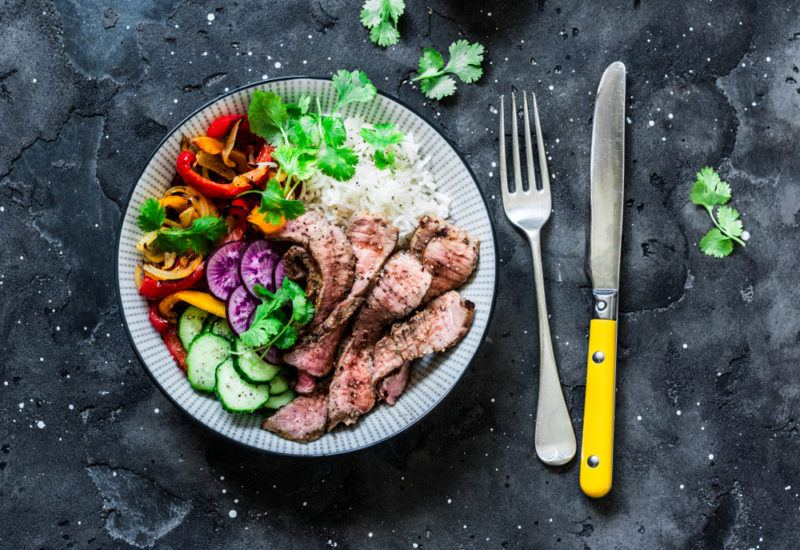 A beef protein bowl with rice and veggies