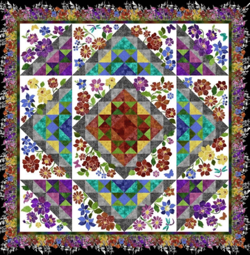 Vibrant laser quilt with blocks with shapes and flowers