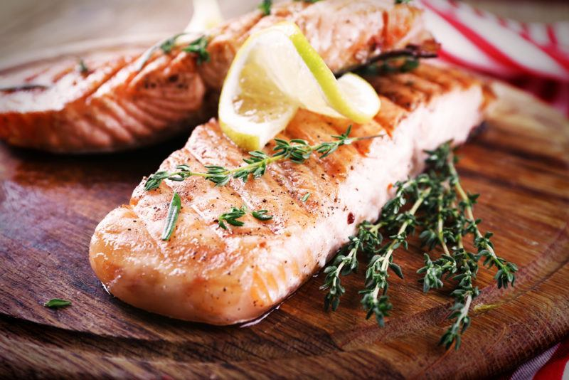 Baked salmon on a wooden board