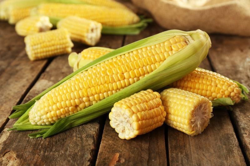 A selection of corn on a wooden table