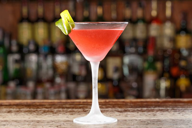 A cosmopolitan cocktail against an out-of-focus bar