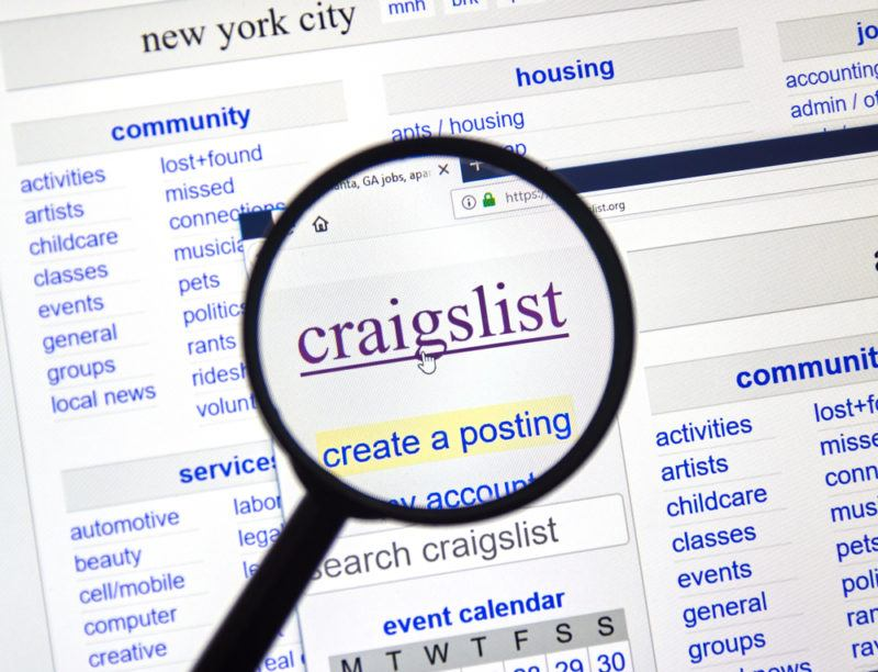 A magnifying glass looking at the Craigslist website
