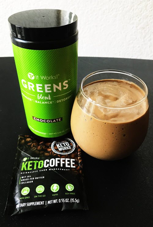 A smoothie in a glass with various keto products
