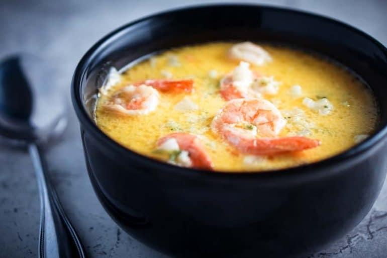 A black bowl with shrimp soup