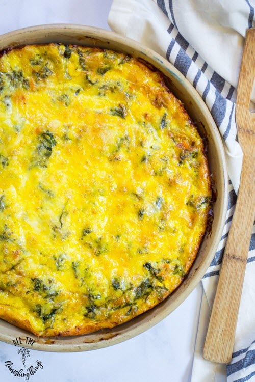 A top down image of a bright yellow quiche