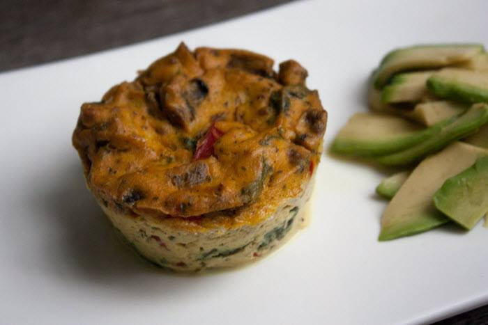 A small quiche with tofu on a white plate.