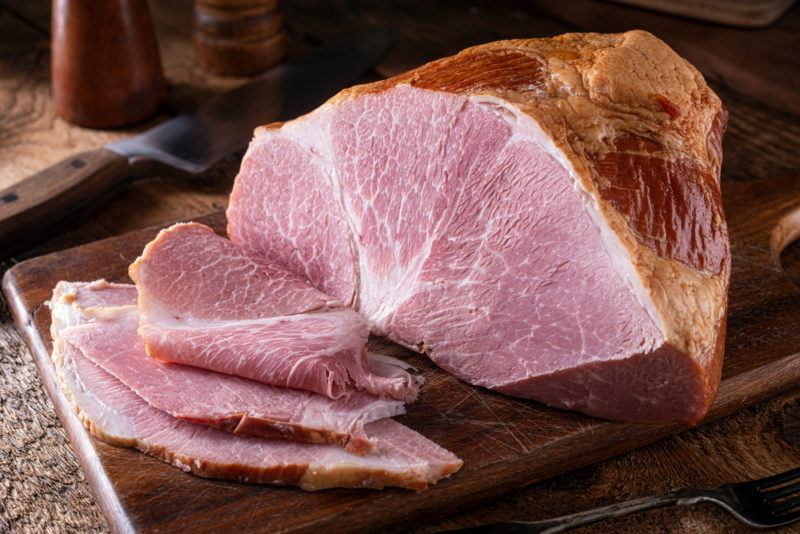Brined ham that has been sliced on a board