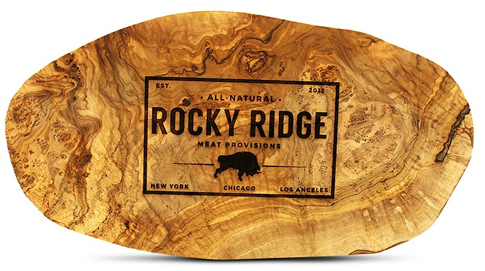 Oval cutting board with a Rocky Ridge Stamp