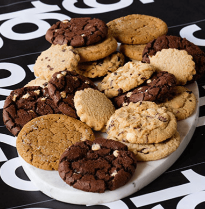 A selection of cookies on a white platter