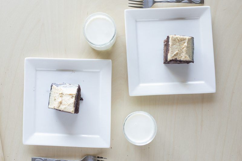 Dark Chocolate Cake Peanut Butter Frosting Chocolate Ganache Top Down Two Plates Square Milk Table