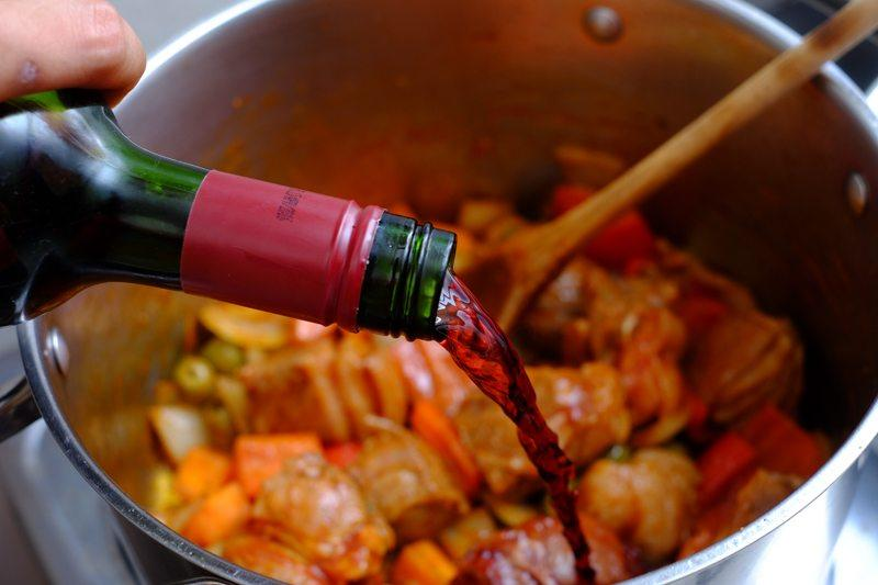 add the red wine to deglaze those drippings