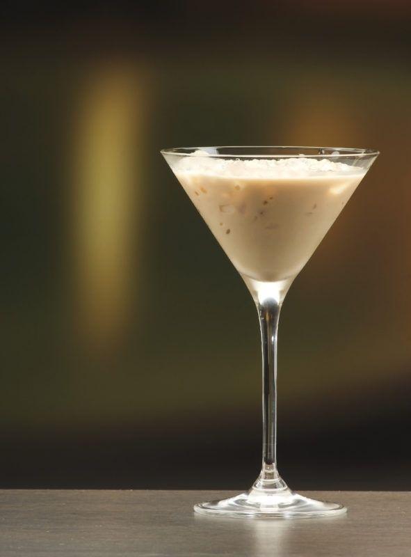 A martini glass with a delce de leche cocktail