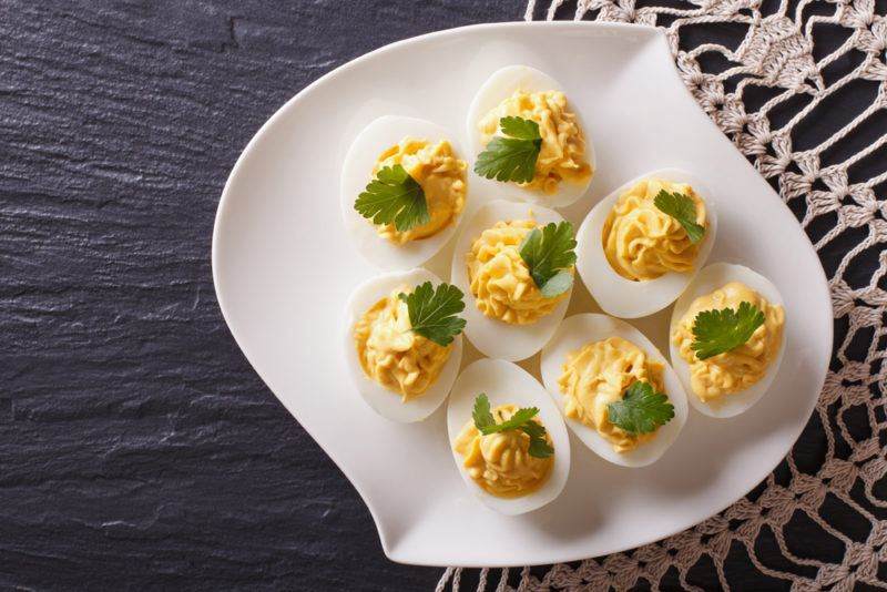 A white dish with deviled eggs