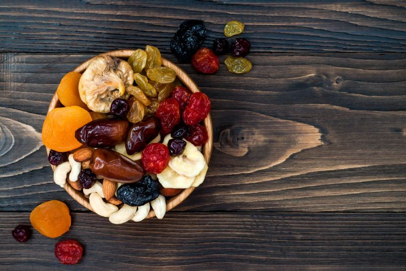 A bowl of dried fruit on a table
