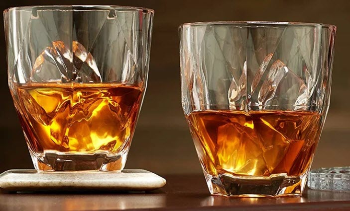 Two whiskey glasses with unusual designs