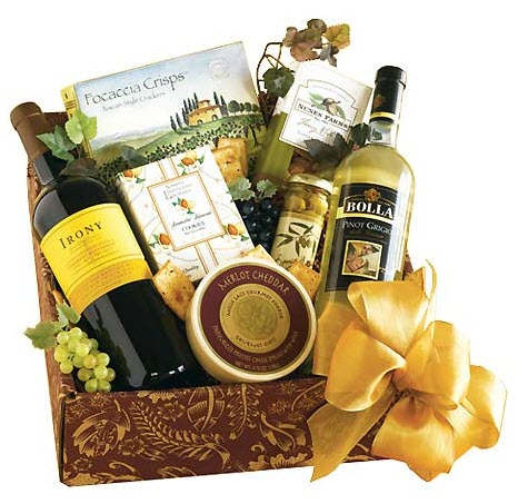 Box containing wine and snacks with a golden bow.