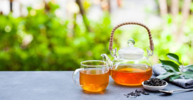 A glass teapot and a glass mug of earl gray tea