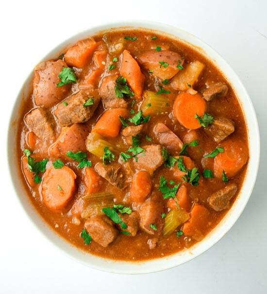 A white bowl with an orange keto stew