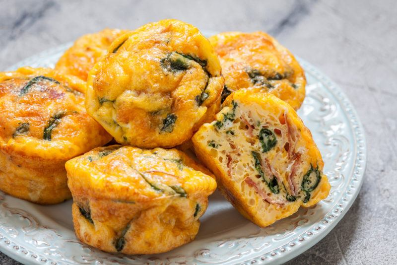 A selection of egg muffins with greens