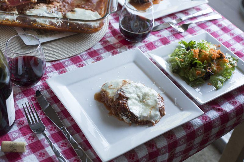 Eggplant Parmesan Two Dishes Square Plate Salad Wine