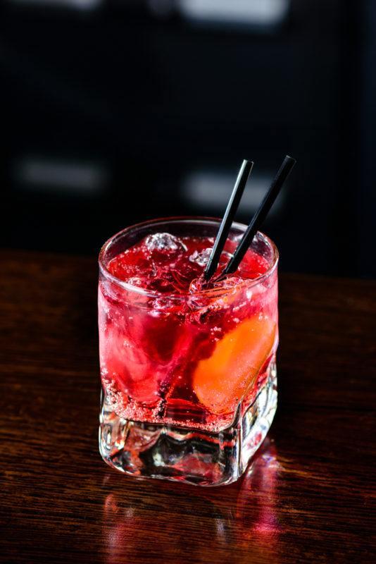 A red El Diablo cocktail on black