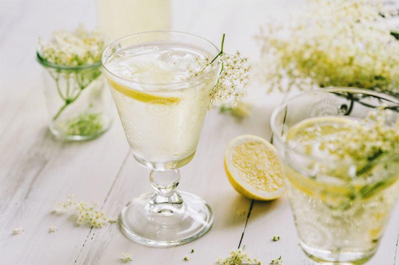 Multiple glasses of elderflower gin and tonic