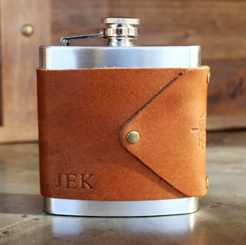 A leather wrapped flask with the initials JEK