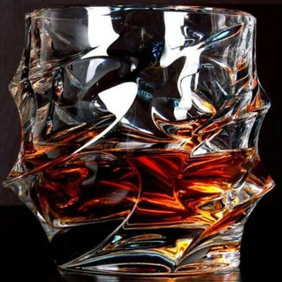 A funky shaped whiskey glass