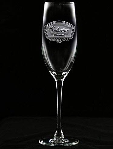 Etched champagne glass against a black background.