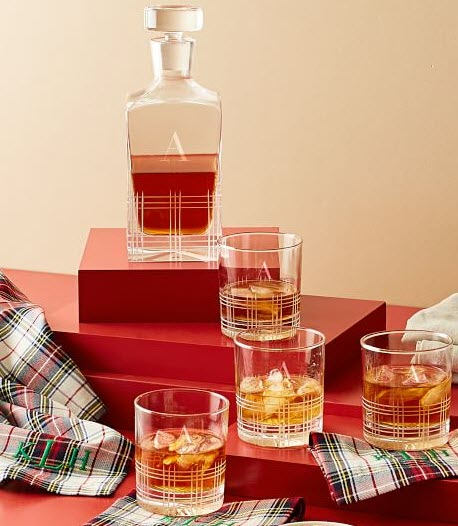 Whiskey decanter and four glasses with a Scottish-like theme