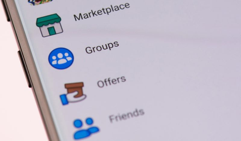 A close up image of a list including Facebook Marketplace and Facebook Groups on an app