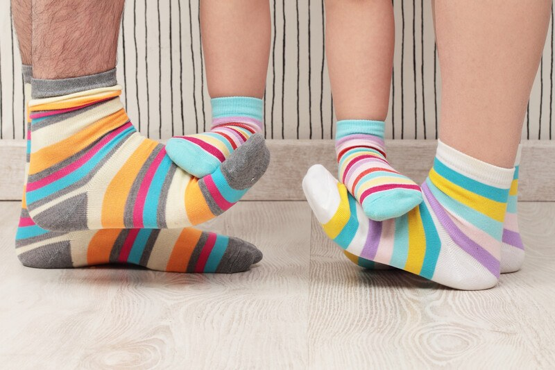 Sock of the Month Clubs - Family in colorful socks, photo features from below the knee down.