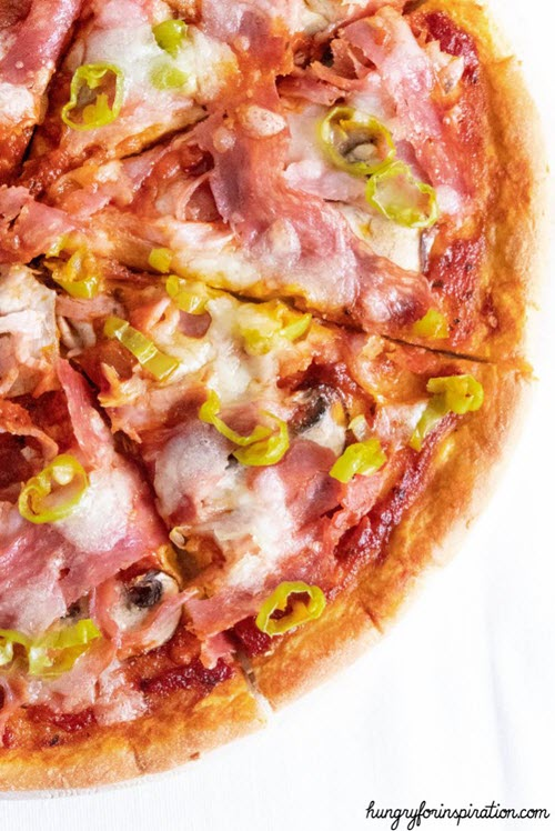 Close up image of a pizza with various slices