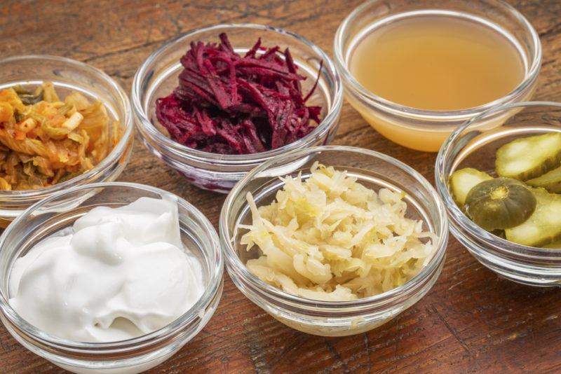 Six bowls of various fermented foods