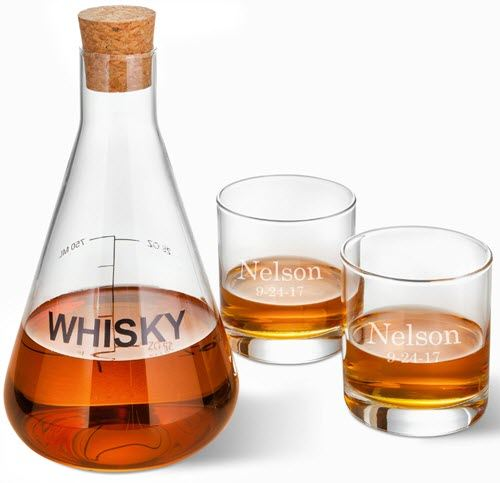 Whiskey decanter shaped like a chemical flask with two engraved glasses