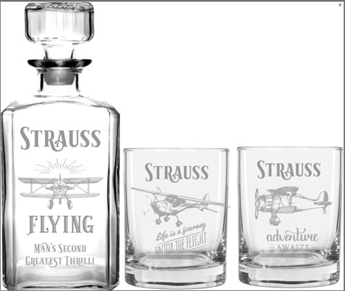Decanter and 2 glasses with planes and the word Strauss