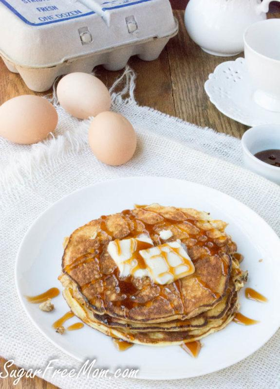 A white plate with a small stack of pancakes