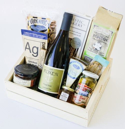 Crate of wine and various snacks