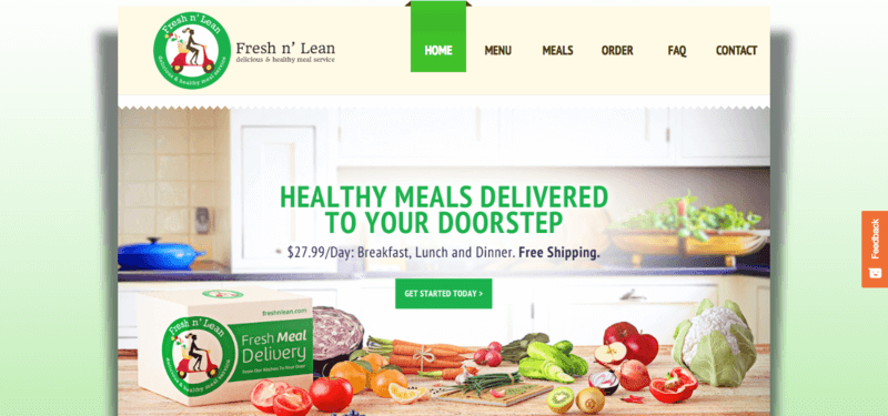 Fresh n' Lean website screenshot showing a wooden kitchen counter with a large range of fruit and vegetables.