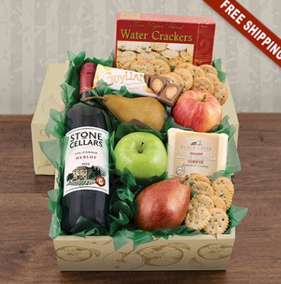 A brown box with crackers, fruit, chocolate and wine