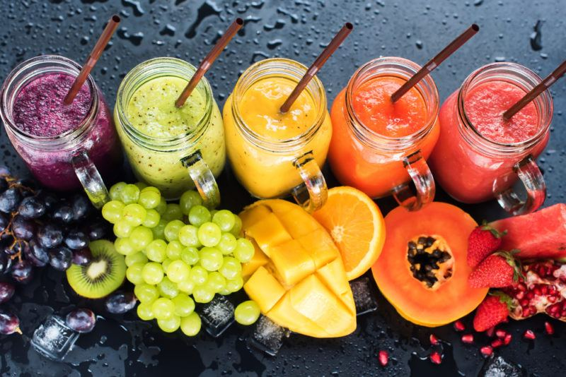 A rainbow selection of fruit smoothies