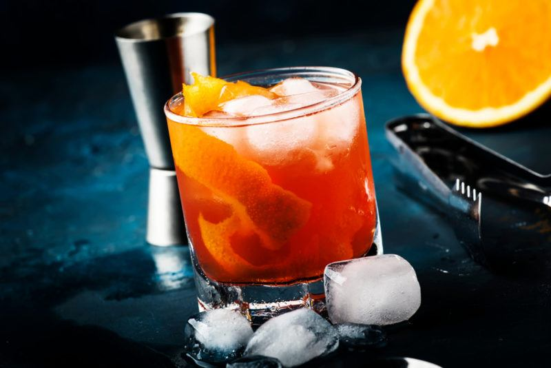 A cocktail glass with an orange Garibaldi cocktail