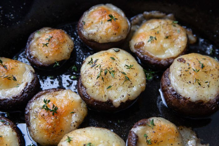 A selection of stuffed mushrooms in a pan