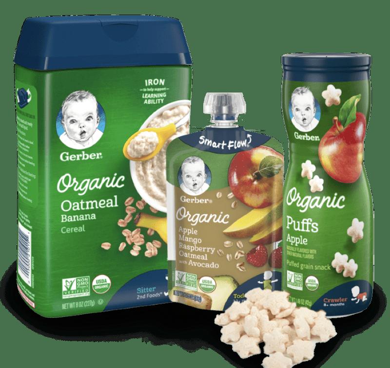 Three gerber products, from left to right, organic oatmeal banana, organic apple mango raspberry oatmeal with avocado, and organic puffs apple flavor