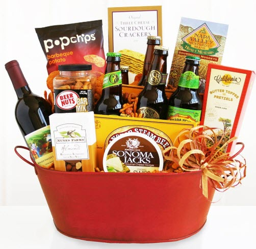 Red basket with wine, beer and casual snacks