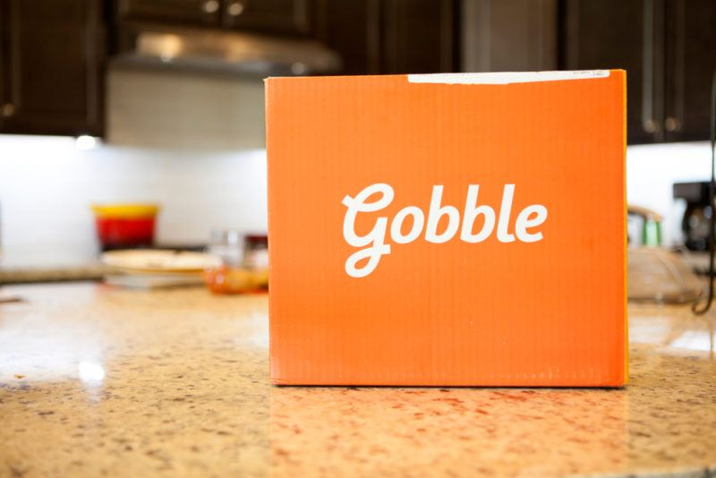 An orange box from Gobble on a kitchen counter