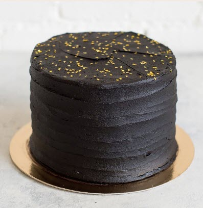 A chocolate cake with gold sprinkles