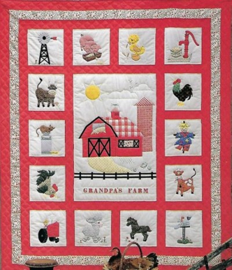 Grandpa's Farm quilt with red background and different farm themed blocks