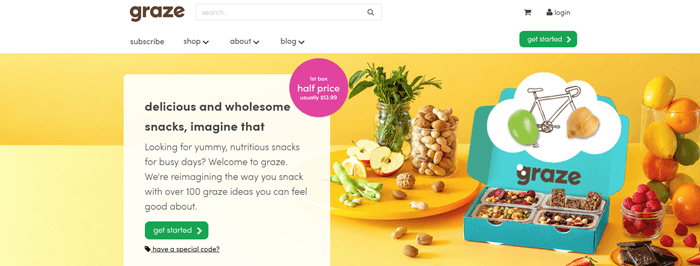Graze website screenshot showing a range of snacks on a yellow table, along with a box from Graze that includes four different snacks.